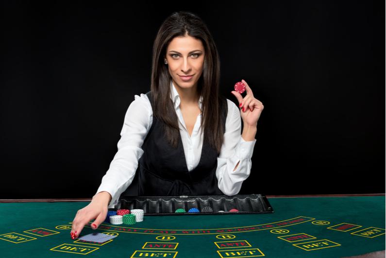 Female table game dealer