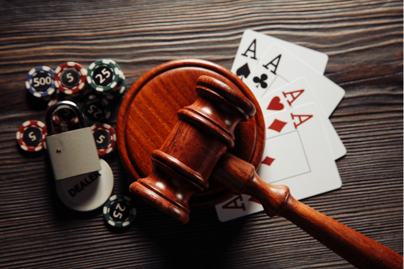 Judge's gavel, playing cards, and poker chips