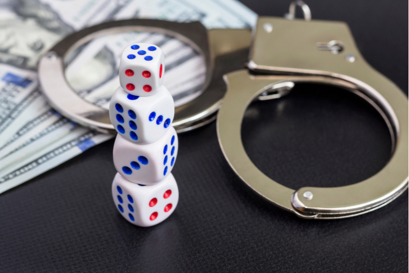handcuffs, cash, and dice