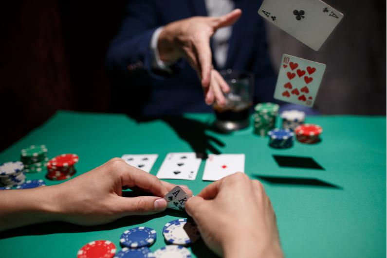 Poker player folding hole cards