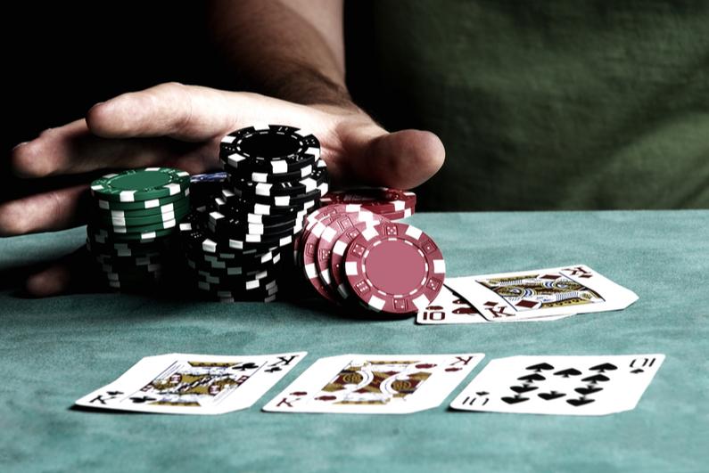 poker player shoving all-in