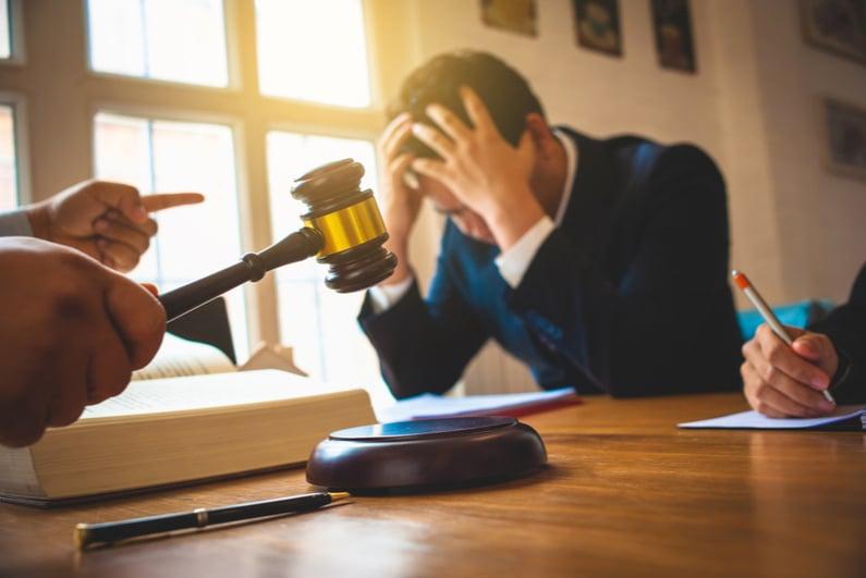 sad businessman after a judge's verdict