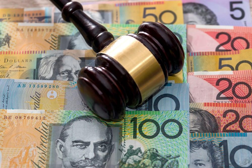 A gavel on Australian dollars