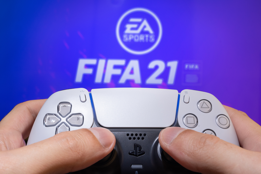 FIFA 21 logo on screen with controller