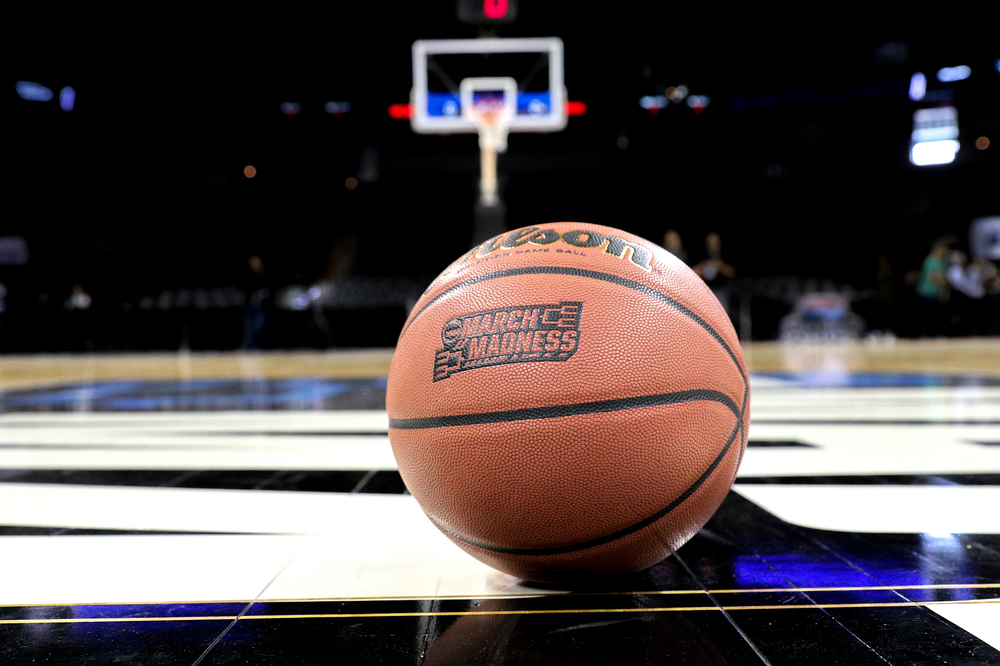 March Madness basketball on court
