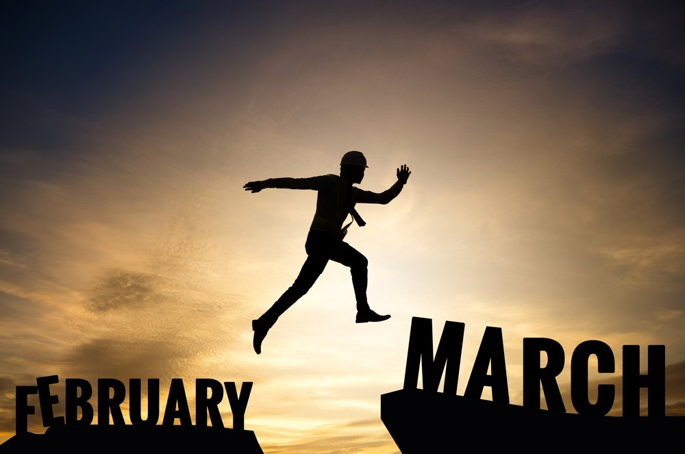 man jumping from February step to March step