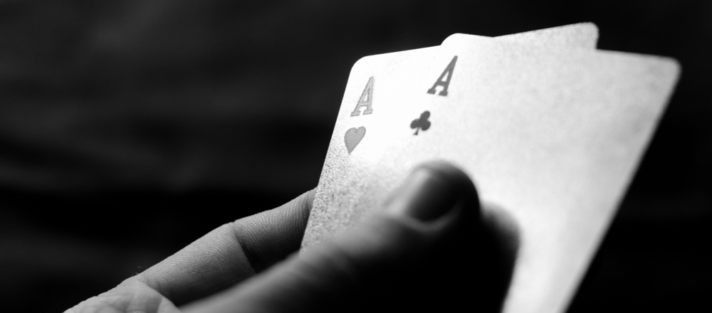 hand holds two Aces cards in poker