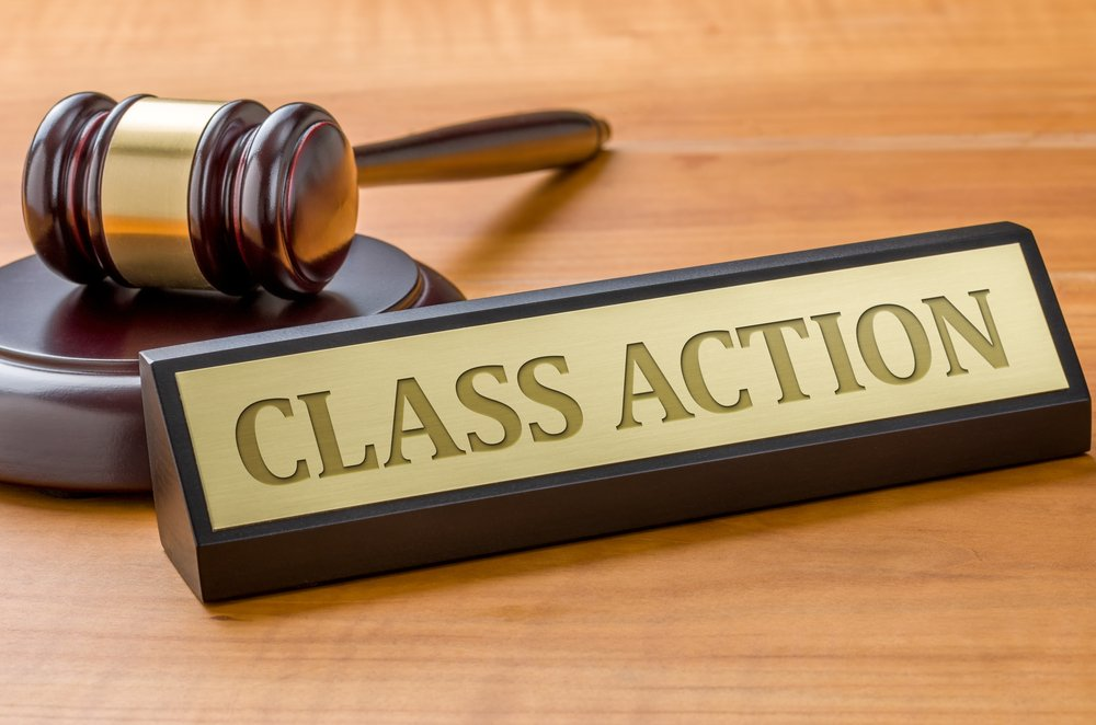 A judge's gavel next to a label reading Class Action