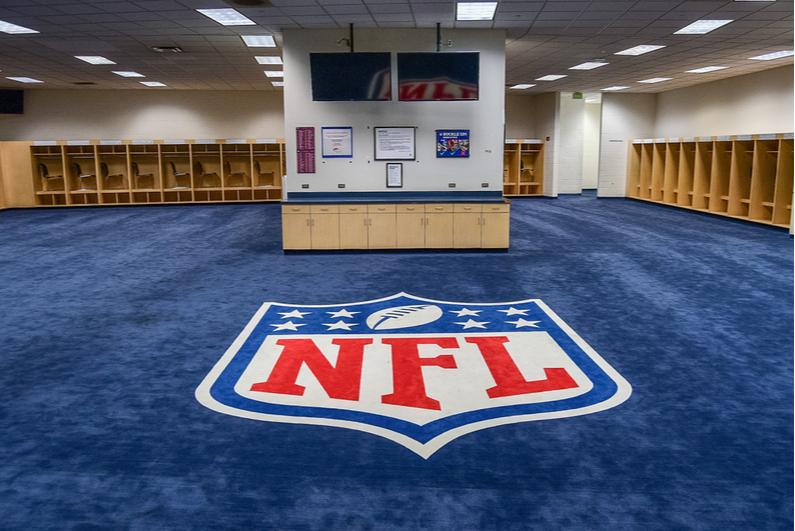 NFL logo on locker room floor