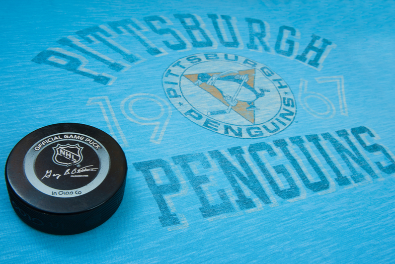 Pittsburgh Penguins logo and puck