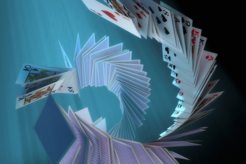 cards falling in spiral formation