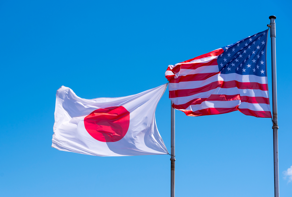 flag of Japan next to a US flag on masts