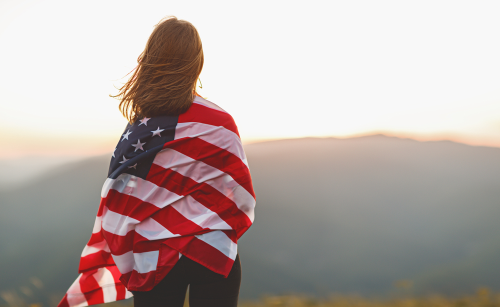 woman wrapped in a US flag
