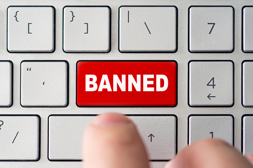 red computer keyboard button reads Banned