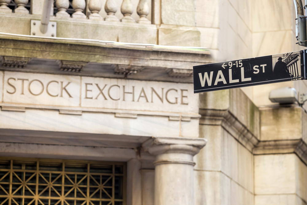 The New York Stock Exchange and Wall Street signs