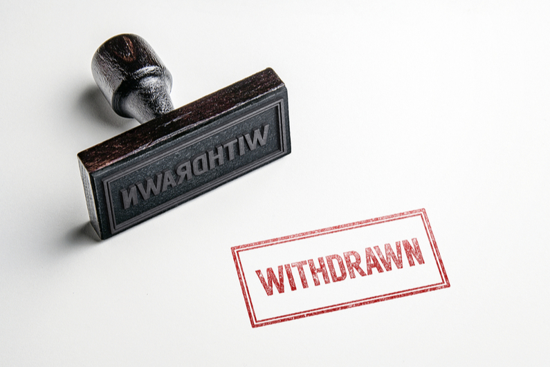 "Rubber stamp reading ""WITHDRAWN"""