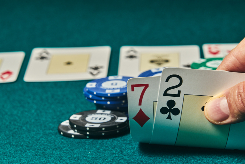 Poker player holding 2-7 offsuit