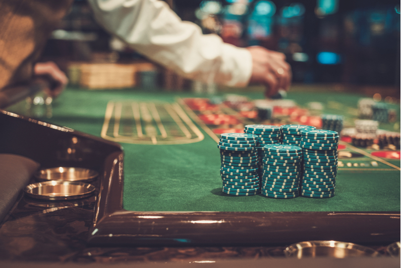 Closeup of chips on a casino gaming table