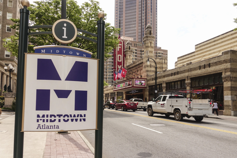 Midtown Atlanta sign with the Fox Theater in the background