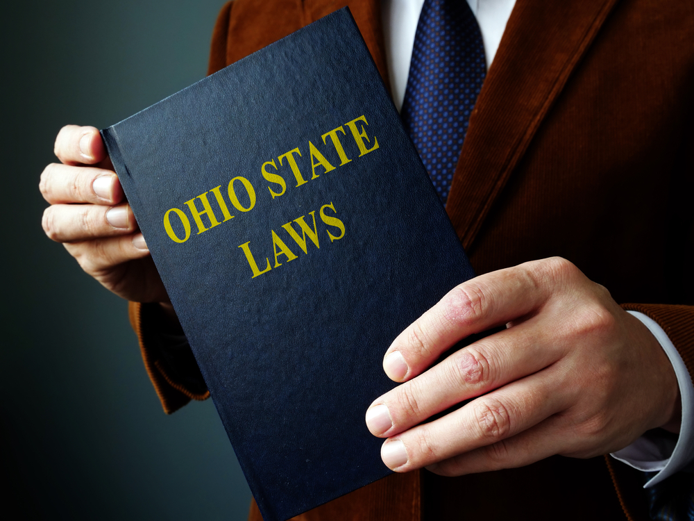Man holding Ohio State Laws book