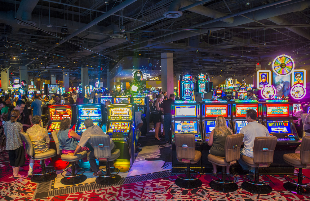 Gamblers playing slots in a busy casino