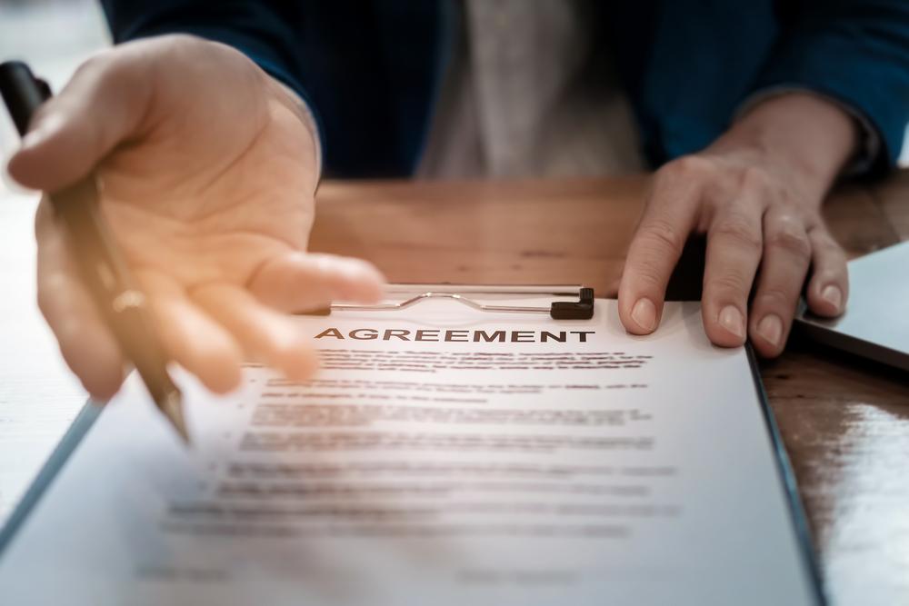 A businessman offering an agreement