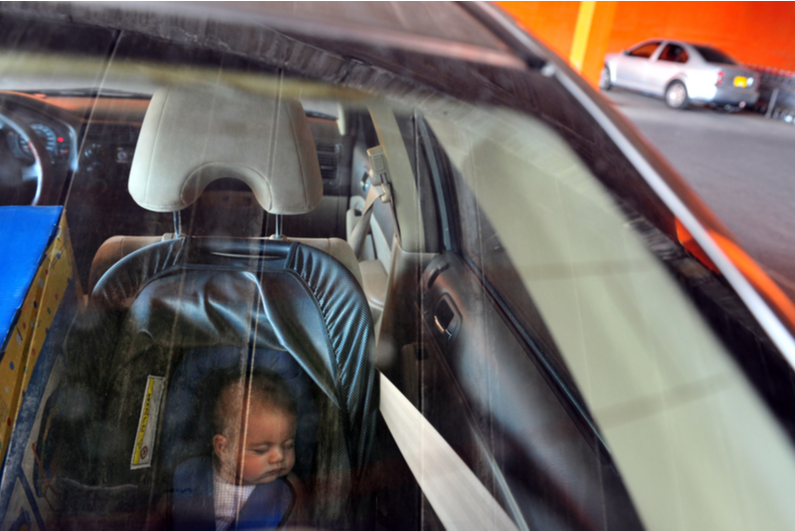 Baby by himself in a car