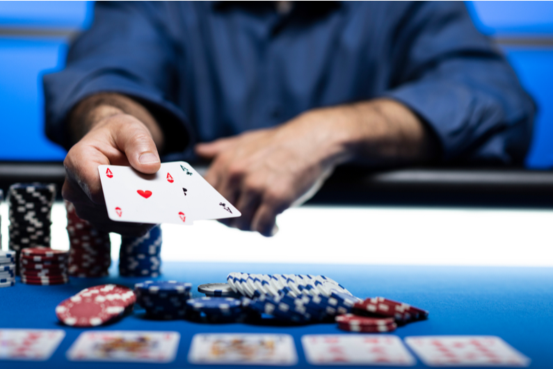 Player across the table revealing two Aces