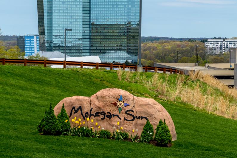 Mohegan Sun logo on a rock outside the casino