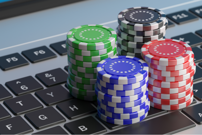 Poker chips stacked on a laptop keyboard