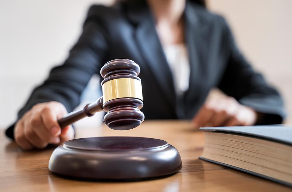 female judge holding gavel