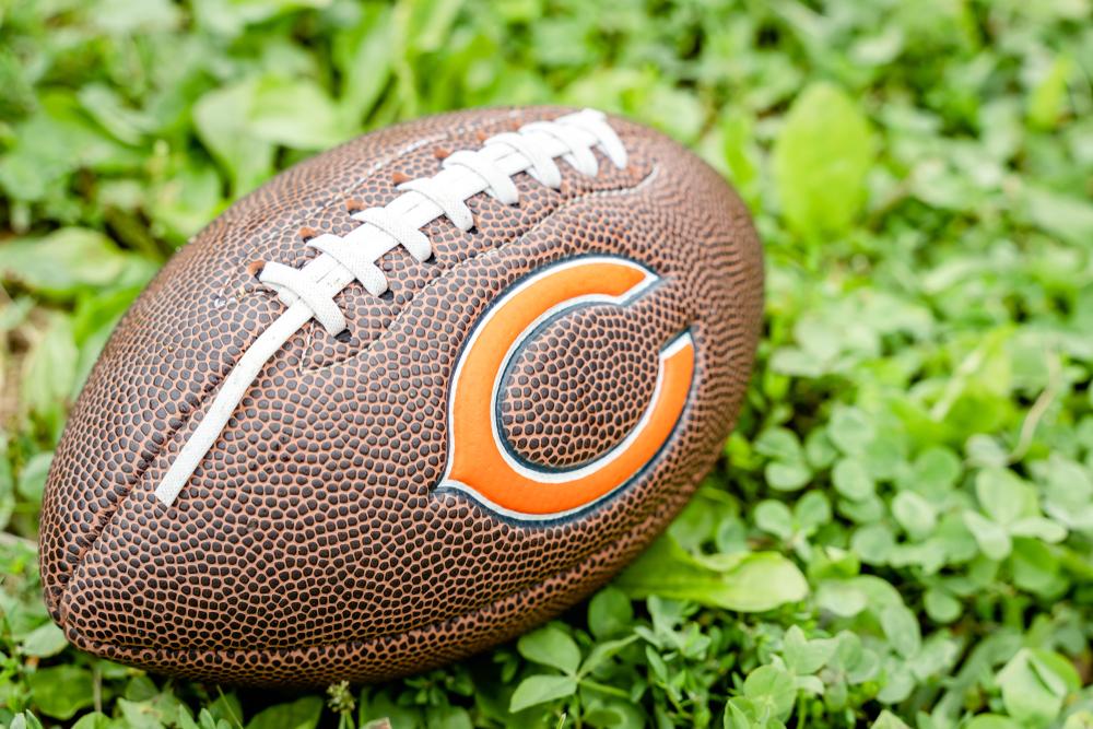 Chicago Bears logo on football on green grass