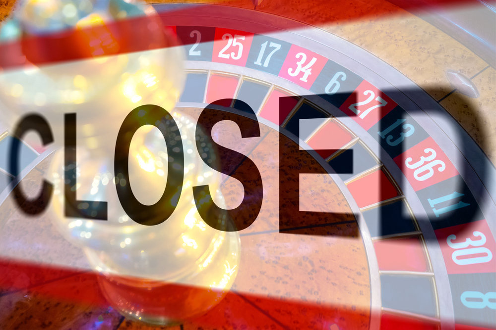 Closed sign in front of roulette wheel