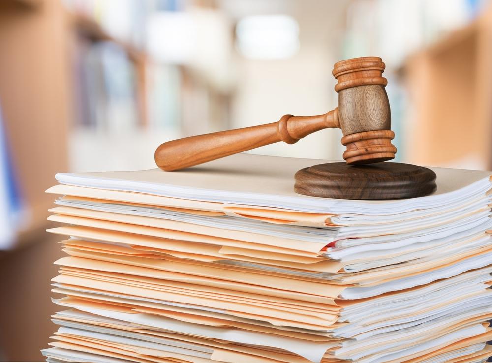 judge's gavel on top of legislative documents