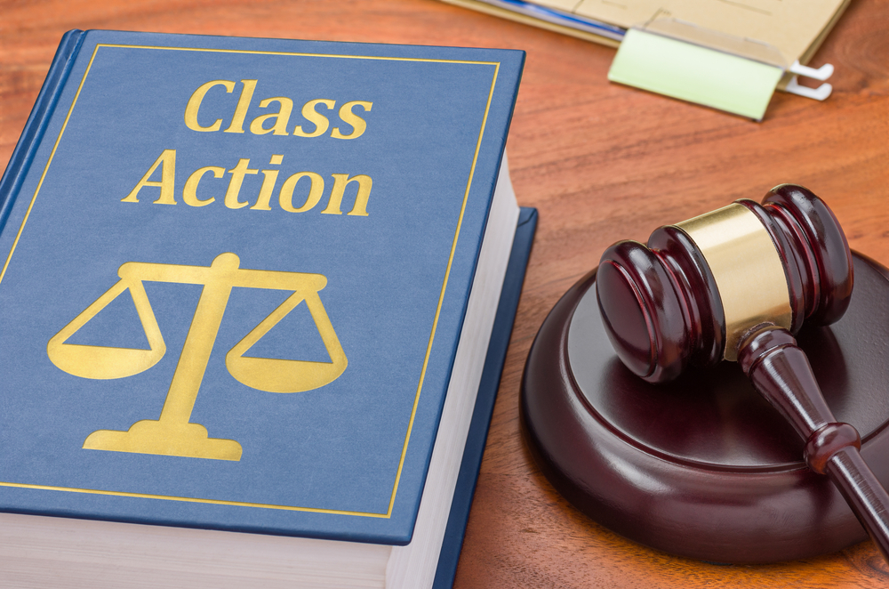 Class Action law book near a judge's gavel