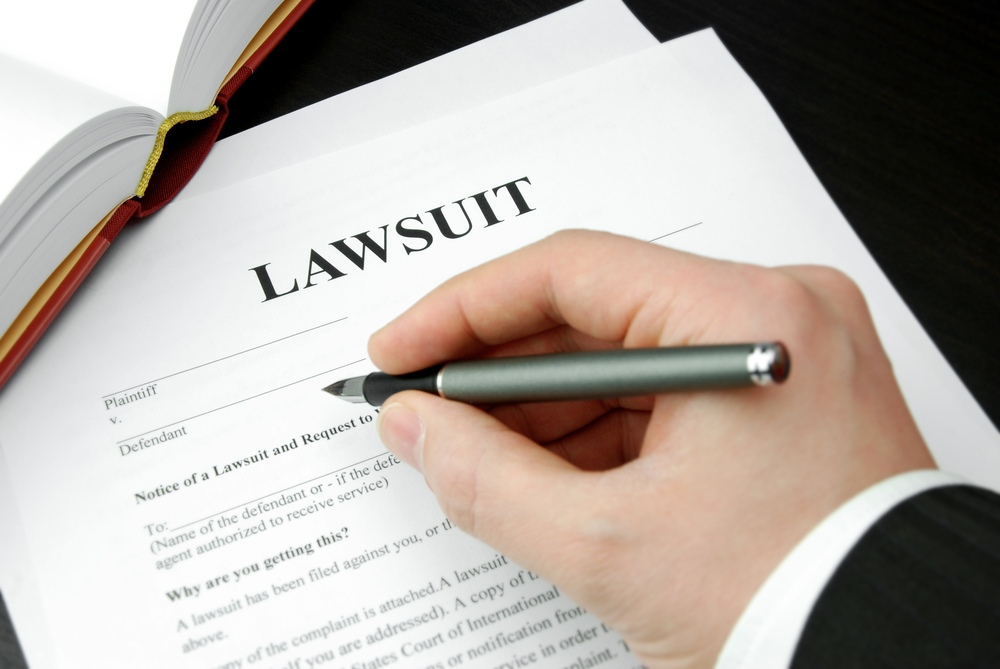 Person signing lawsuit document