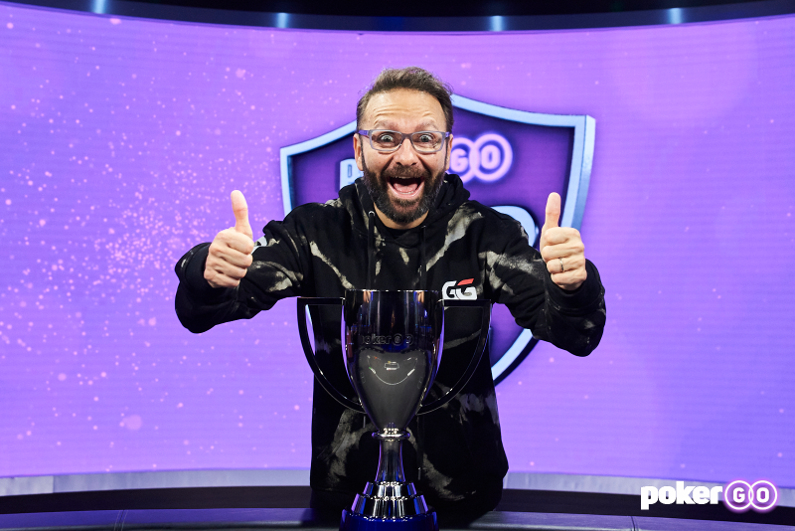 Daniel Negreanu posing with his trophy as the 2021 PokerGO Cup Champion