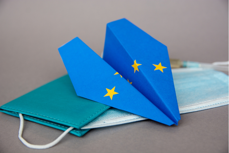 Paper plane with an EU flag design and a protective mask