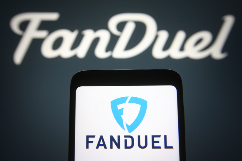 FanDuel logo on a smartphone and in the background