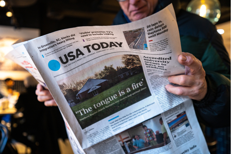 Man reading the USA Today