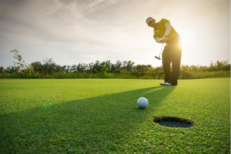 Golfer putting toward the camera