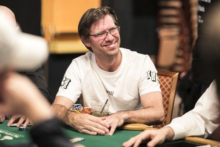 Poker pro player Layne Flack at a poker tournament table
