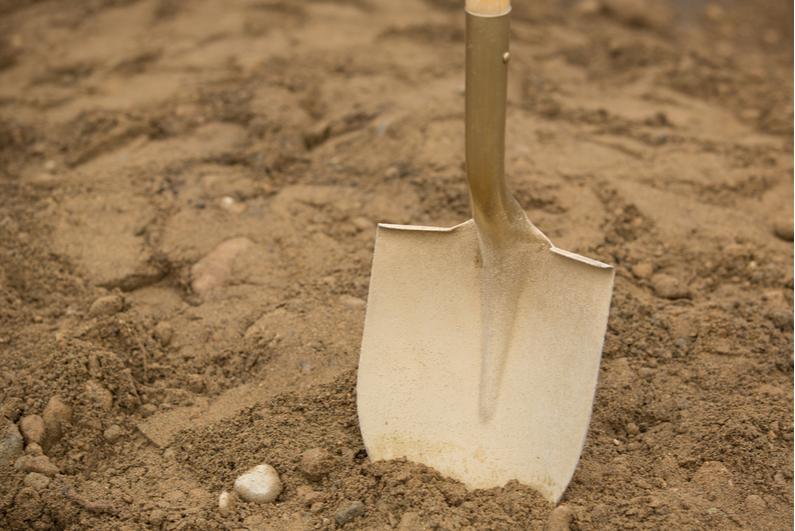 shovel breaking ground