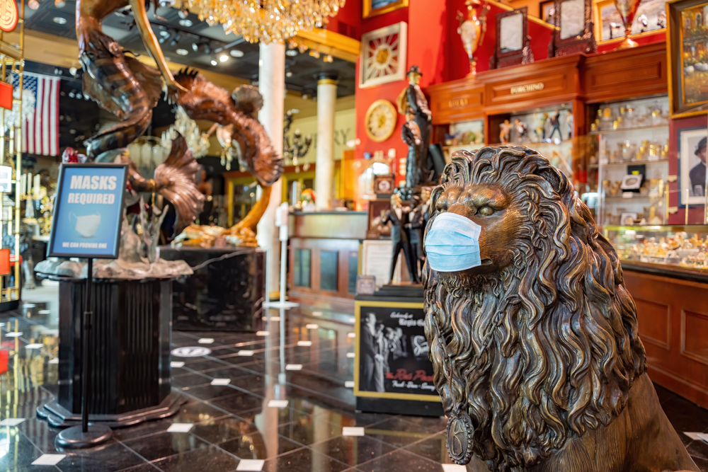surgical mask placed on lion statue inside a Las Vegas casino