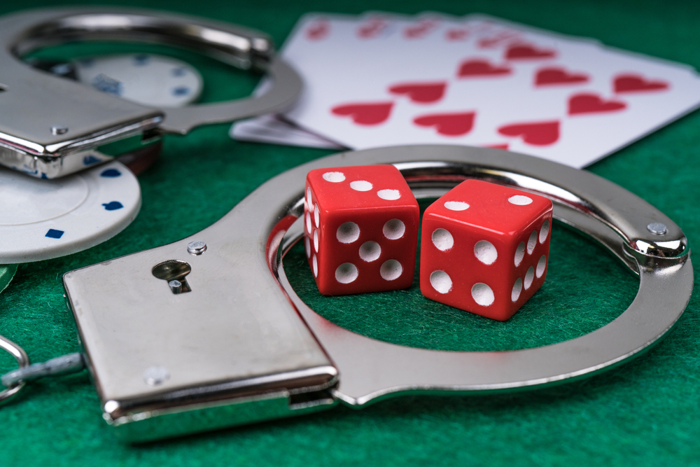 Handcuffs and dice with playing cards