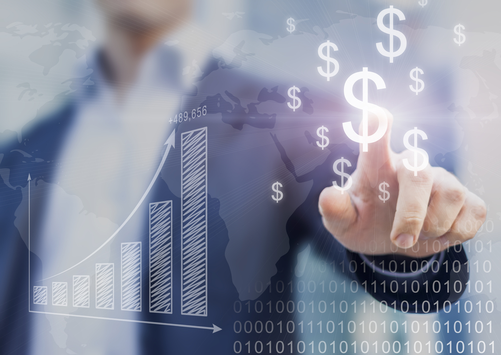 businessman touches clear screen with dollar signs and graph indicating financial growth