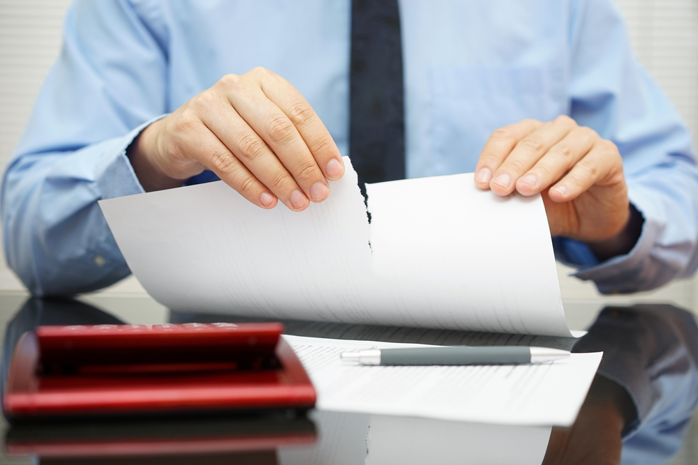 Man ripping up document