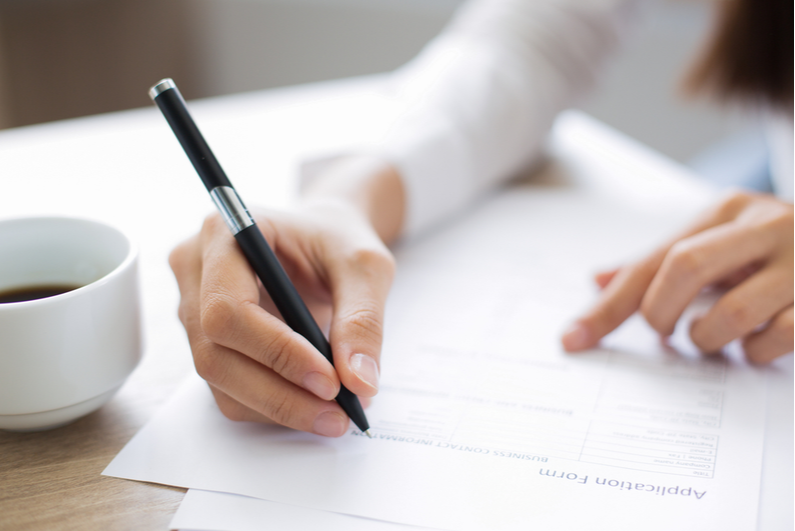 woman filling out an application form