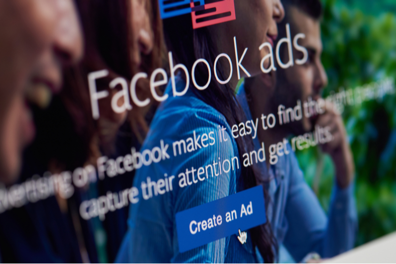 Closeup of monitor showing the intro to the Facebook ad creator app