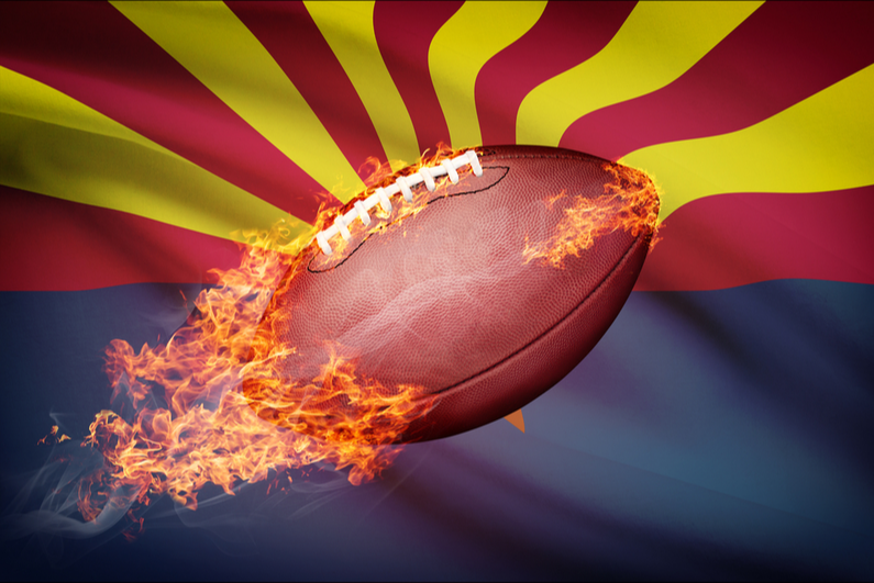 Football on fire in front of Arizona flag